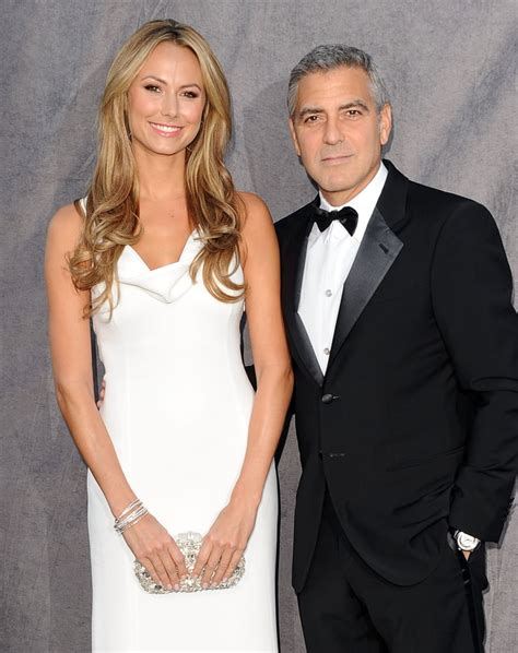 Stacy Keibler wore a white dress as George Clooney's