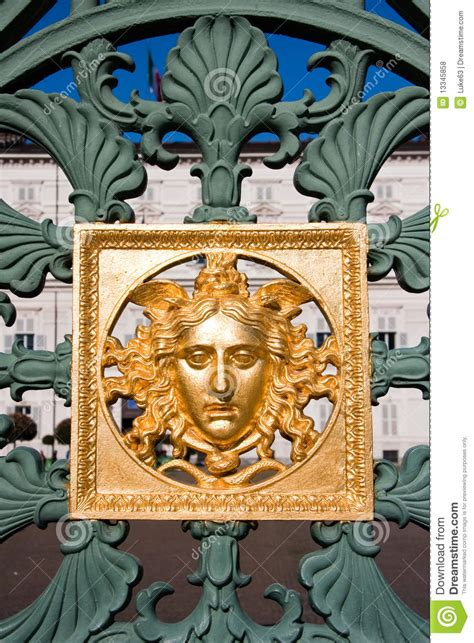 Golden Mask On Fence - Royal Palace - Turin Italy Stock